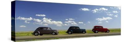 Three Hot Rods Moving on a Highway, Route 66, USA