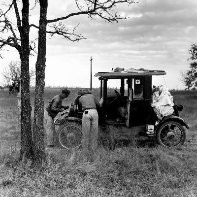 Three Men Working on 1918 Ford Model T - Has Bundles in Back and Can of Prestone on Running Board-Charles E^ Steinheimer-Photographic Print