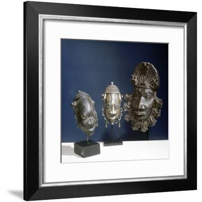 Three ornamental brass hip-masks which formed part of the regalia of Benin chiefs, Benin, Nigeria-Werner Forman-Framed Giclee Print