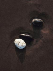 Three Pebbles on Sand