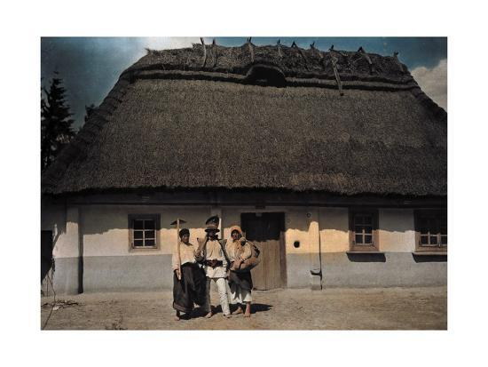 Three People Stand in Front of a House after Returning from Work-Hans Hildenbrand-Photographic Print