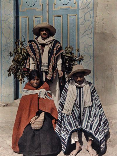 Three Poncho-Clad Quichua Indians Stand in Front of a Colorful Door-Jacob Gayer-Photographic Print