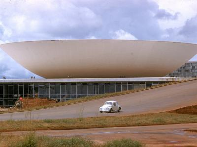 Three Powers Square Building Built by Oscar Niemeyer as Volkwagan drives by-Dmitri Kessel-Photographic Print