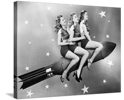 Three Women Sitting on Rocket--Stretched Canvas Print