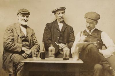 Three Working Men Enjoying a Drink--Photographic Print