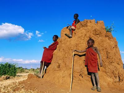 Three Young Maasai Goat Herds on a Termite Mound, Longido, Arusha, Tanzania-Ariadne Van Zandbergen-Photographic Print