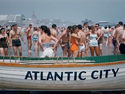 Throngs of Swimmers Stroll Behind a Wooden Lifeboat on the Beach-Volkmar K^ Wentzel-Photographic Print