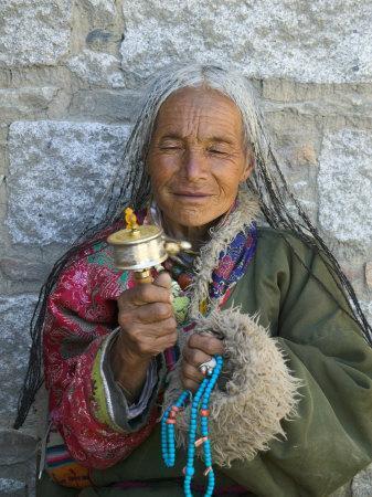 https://imgc.artprintimages.com/img/print/tibetan-woman-holding-praying-wheel-in-sakya-monastery-tibet-china_u-l-pxpmdl0.jpg?p=0