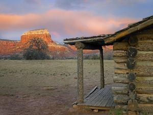 Sunset over Kitchen Mesa and Pioneer Cabin Near Ghost Ranch, New Mexico, Usa by Tim Fitzharris
