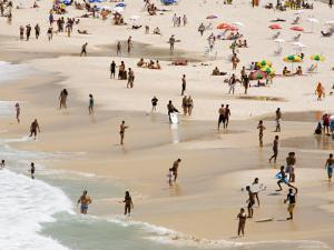 People Enjoying the Beach and Surf at Ipanema Beach by Tim Hughes