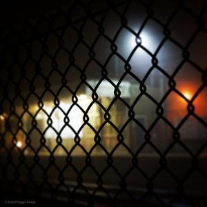 Wire Fence by Train Srtation by Tim Kahane
