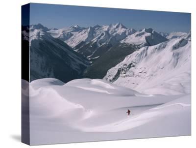 A Skier Heads Down Mount Swanzy