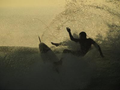 A Surfer Wipes out on a Breaking Wave