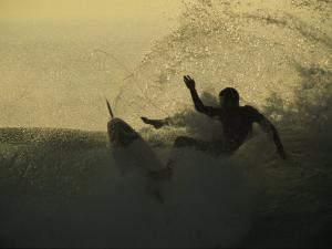 A Surfer Wipes out on a Breaking Wave by Tim Laman