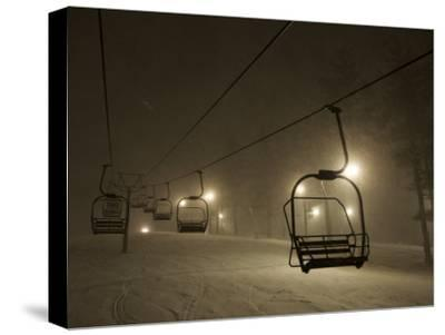 Night Skiing During a Snowstorm - View of Ski Lifts