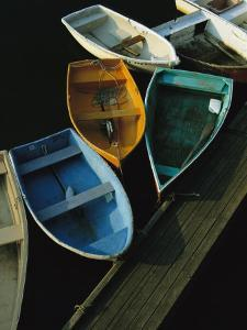 Skiffs Tied up at a Dock in the Inner Harbor at Rockport by Tim Laman