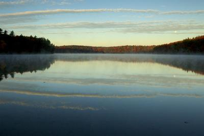The sky reflects in Walden Pond.