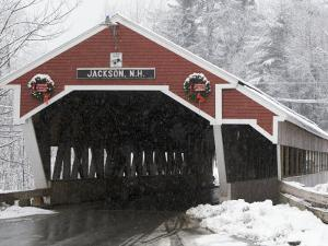 Traditional Covered Bridge on a Snowy Day in Jackson, Nh by Tim Laman