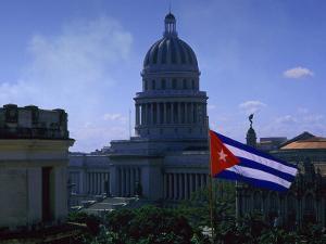 Flag and Capitol Building, Havana, Cuba by Tim Lynch