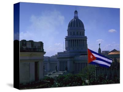 Flag and Capitol Building, Havana, Cuba