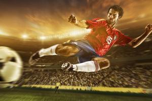 Soccer Player Mid-Air Kicking Ball, Brazil, South America by Tim Tadder