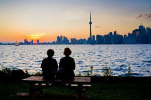 A Couple Watches the Sunset over Toronto Skyline from Centre Island by Tim Thompson