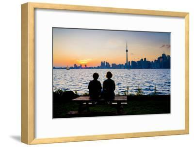 A Couple Watches the Sunset over Toronto Skyline from Centre Island