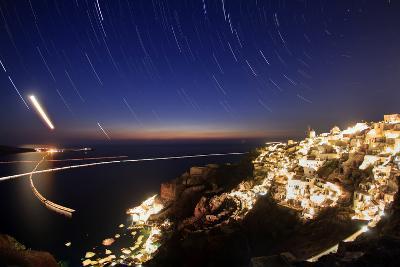 Time-Exposure Image of Santorini Island at Night with Star Trails around Polaris-Babak Tafreshi-Photographic Print