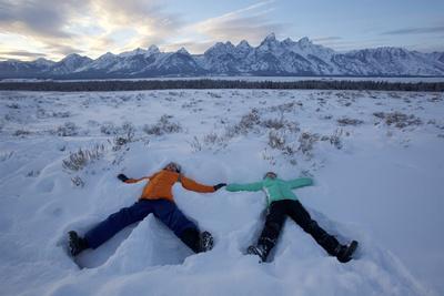 Boy and Girl Making Snow Angels Below the Tetons, Grand Teton National Park, Wyoming