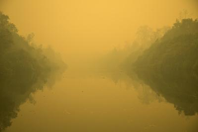 Thick Smoke From Forest Fires Above The Mangkutup River.