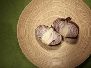 A Two One-Halfs of a Red Onion on a Wooden Plate by Tina Chang