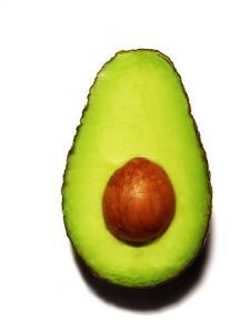 Half an Avocado on a White Background by Tina Chang