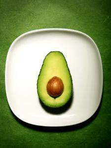 Half an Avocado on a White Plate by Tina Chang
