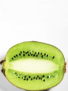 Half of Kiwi Fruit on White Background by Tina Chang