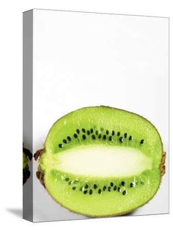 Half of Kiwi Fruit on White Background