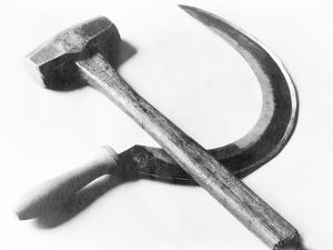 Mexican Revolution: Hammer and Sickle, Mexico City, 1927 by Tina Modotti