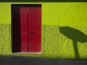 A Green Building with a Red Door in Merida by Tino Soriano