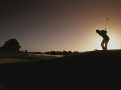 A Man Plays a Game of Golf at Twilight by Tino Soriano