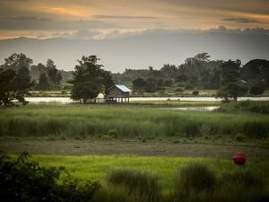 A Small House on Stilts Beside the Irrawaddy River by Tino Soriano