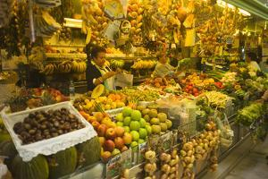 A Vendor Selling Fruits at the El Fontan Market in Oviedo, Spain by Tino Soriano