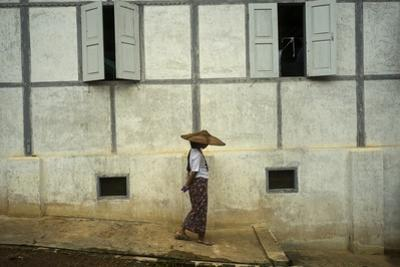 A Woman Walks Past a Meditation Center by Tino Soriano