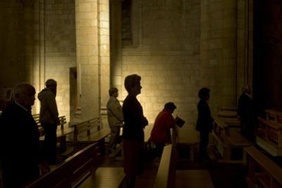 People Praying at the San Isidoro Church in Leon, Spain by Tino Soriano