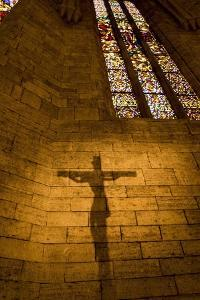 The Shadow of a Crucifix Is Projected on the Wall of the Church of Santa Maria De Porqueres by Tino Soriano