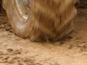 Tire Churning Through Mud