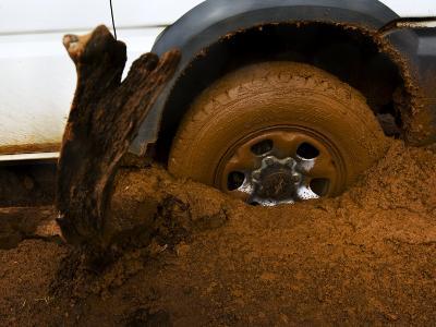 Tire Spinning in Deep Clay Mud-Mattias Klum-Photographic Print