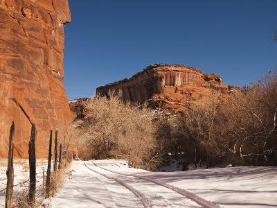 Tire Tracks in the Snow at the Canyon De Chelly Cliffs-James Forte-Photographic Print
