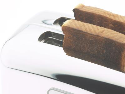 Toast Popping out of Sleek Stainless Steel Toaster--Photographic Print