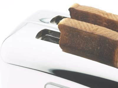 Toast Popping out of Sleek Stainless Steel Toaster