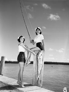 Toby Gerard and Barbara Wartell Strike Fishy Poses, April 1951