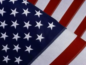 A Close-up of the Stars and Stripes of an American Flag by Todd Gipstein